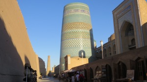 "A street view in Khiva with the ""unfinished"" minaret in the foreground."