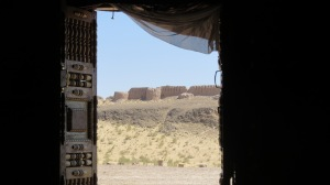 Last view of fortress from doorway of a yurt.