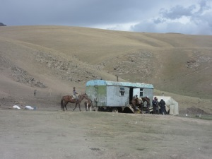 Nomads with yurts in the high pastures