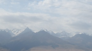 A view of the Tien Shan mountains, with the sun in the wrong place.