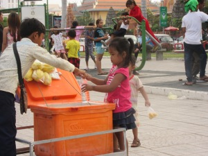 A young entrepreneur, selling water.