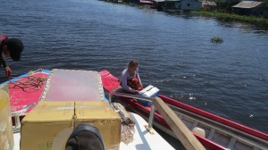 A lady picking up supplies from our boat.