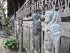 Statues outside Tribal Longhouse.