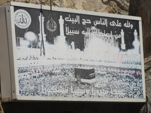 Poster outside a house to inform people that residents have performed Haj. Pilgrimage to Mecca.