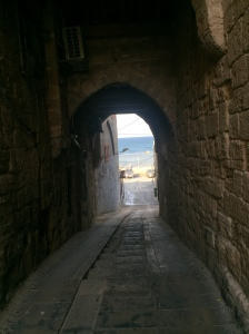 A view through the walls giving you some idea how thick they were. Blue sea beyond.